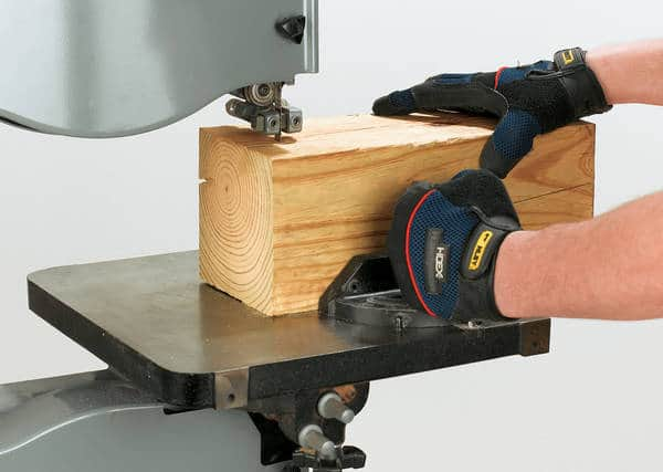 Person slicing timber - End grain flooring
