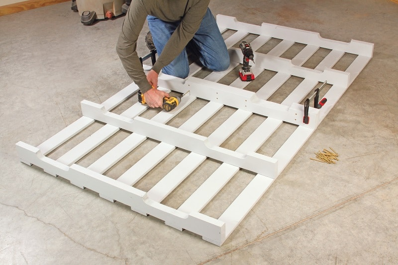 Builder fastening two pallets together - DIY platform bed