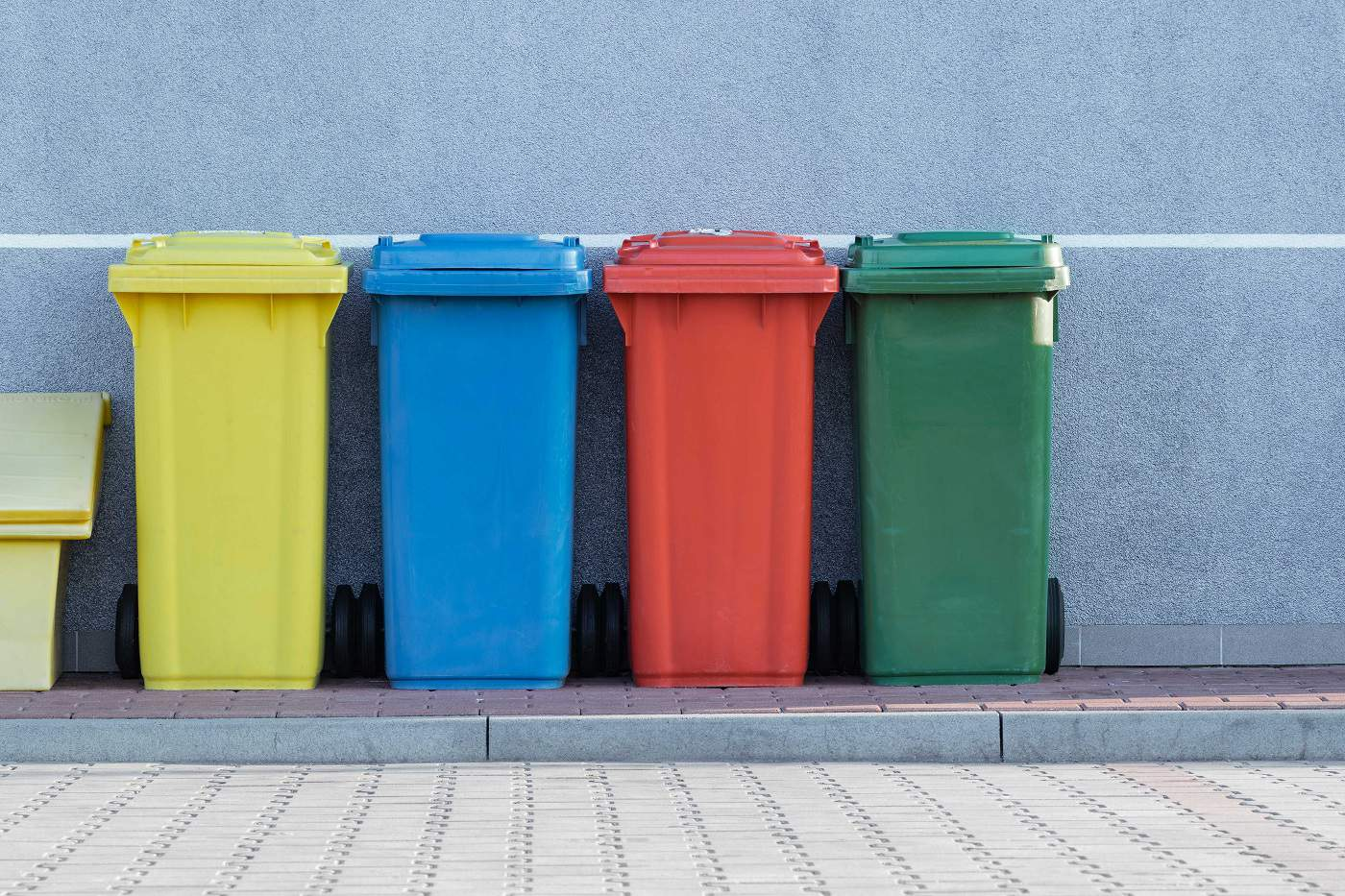 Different colored waste bins for different types of waste from Paweł Czerwiński via Unsplash